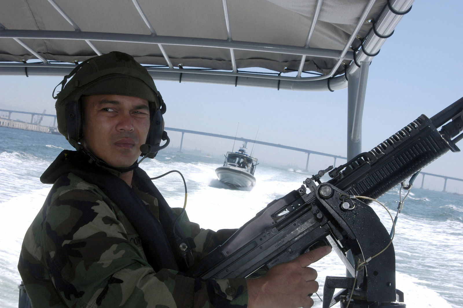 U.S. Navy Storekeeper 1ST Class Ronilo Cortez, from Inshore Boat Unit (IBU) 52, mans a .50 caliber machine gun onboard his 27-foot SeaArk RAM Series Rigid Hull Inflatable Boat during Exercise Seahawk 2006 at Naval Amphibious Base Coronado, Calif., on Aug. 23, 2006. Seahawk 2006 is a combined anti-terrorism and force protection training involving units under the U.S. Navy Expeditionary Combat Command (NECC) on the West Coast and Sailors from commands based in California, Washington and Oregon. (U.S. Navy photo by Mass Communication SPECIALIST SEAMAN Apprentice Rialyn C. Rodrigo) (Released)