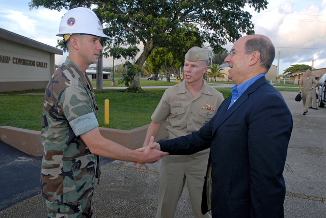 The Honorable Dr. Donald C. Winter (right), Secretary of the U.S. Navy (SECNAV), shakes hands with LT. CMDR. Scott Loeschke, Executive Officer, Naval Mobile Construction Battalion 40, during a meet and greet breakfast at Camp Covington Galley onboard Naval Base Guam on Aug. 25, 2006. The Seabees are currently deployed to Guam. They also have detachments deployed in Iraq and Afghanistan. (U.S. Navy photo by Mass Communication SPECIALIST 2nd Class John F. Looney) (Released)