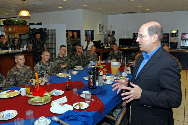 The Honorable Dr. Donald C. Winter (right), Secretary of the U.S. Navy (SECNAV), speaks with Seabees from Naval Mobile Construction Battalion 40, during a meet and greet breakfast at Camp Covington Galley onboard Naval Base Guam. The Seabees are currently deployed to Guam on Aug. 25, 2006. They also have detachments deployed in Iraq and Afghanistan. (U.S. Navy photo by Mass Communication SPECIALIST 2nd Class John F. Looney) (Released)