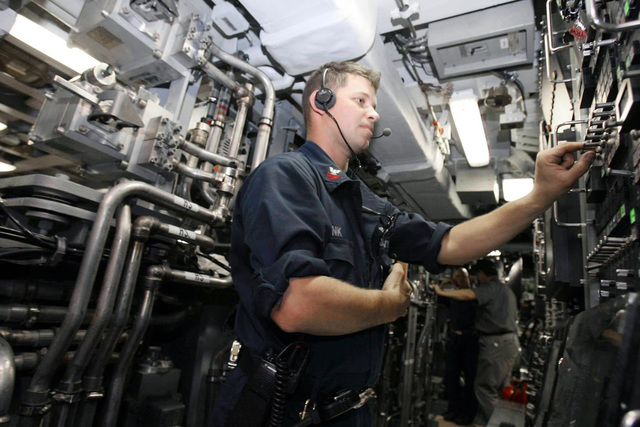 U.S. Navy PETTY Officer 1ST Class Raymond Monk assists in a shipboard test evolution aboard the Virginia Class New Attack Submarine Pre-Commissioning Unit (PCU) TEXAS (SSN 775) at Canaveral, Fla., Aug. 25, 2006. TEXAS and her crew were firing water through torpedo tubes as a part of the testing cycle. The second boat in her class, TEXAS is able to attack targets ashore with highly accurate cruise missiles and conduct covert long-term surveillance of land areas, littoral waters or other naval forces. Other missions include anti-submarine and anti-ship warfare, special forces delivery and support, mine delivery and minefield mapping. TEXAS will be commissioned Sept. 9, 2006 at the...