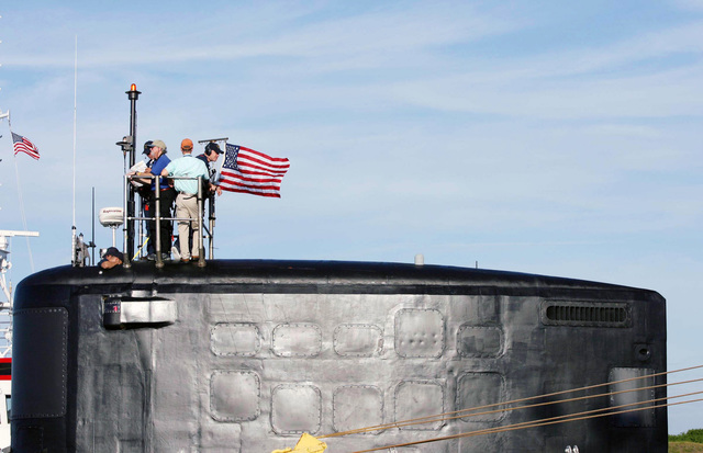 U.S. Navy Sailors and members of the local media stand topside as the Virginia Class New Attack Submarine Pre-Commissioning Unit (PCU) TEXAS (SSN 775) arrives at Port Canaveral, Fla., Aug. 25, 2006. The second boat in her class, TEXAS is able to attack targets ashore with highly accurate cruise missiles and conduct covert long-term surveillance of land areas, littoral waters or other naval forces. Other missions include anti-submarine and anti-ship warfare, special forces delivery and support, mine delivery and minefield mapping. TEXAS will be commissioned Sept. 9, 2006 at Port of Galveston Pier, Texas. (U.S. Navy photo by Mass Communication SPECIALIST 2nd Class Roadell Hickman) (Released)