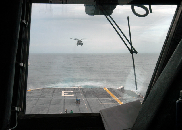 A U.S. Navy MH-53E Sea Dragon helicopter lifts off from the Wasp Class Amphibious Assault Ship USS KEARSARGE (LHD 3), to conduct mine countermeasures on Aug. 26, 2006. The KEARSARGE is particpating in PANAMAX 2006, a multi-national exercise tailored to the defense of the Panama Canal.(U.S. Navy photo by Mass Communication SPECIALIST SEAMAN Christopher Newsome) (Released)