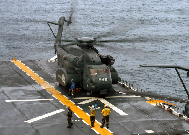 A U.S. Navy MH-53E Sea Dragon helicopter prepares to lift off from the Wasp Class Amphibious Assault Ship USS KEARSARGE (LHD 3), to conduct mine countermeasures on Aug. 26, 2006. The KEARSARGE is particpating in PANAMAX 2006, a multi-national exercise tailored to the defense of the Panama Canal.(U.S. Navy photo by Mass Communication SPECIALIST SEAMAN Christopher Newsome) (Released)