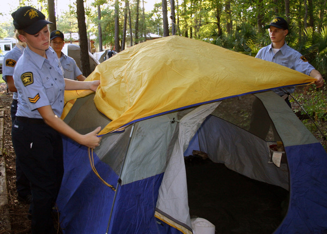 U.S. Naval Sea Cadets Corps members from Franklin D. Roosevelt Squadron (FDR) Squadron prepare their tent during their monthly drill weekend onboard Naval Air Station Jacksonville, Fla., on Aug. 26, 2006. The Naval Sea Cadet Corps is a national, federally chartered youth training organization, which helps youths, ages 11 to 17, to explore careers in the military. (U.S. Navy photo by Mass Communication SPECIALIST 2nd class Susan Cornell) (Released)