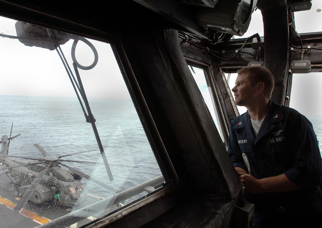 U.S. Navy PETTY Officer 3rd Class Jonathan Matheny, Aviation Boatswain's Mate, mans the watch aboard the Wasp Class Amphibious Assault Ship USS KEARSARGE (LHD 3) during mine countermeasure operations, Aug. 26, 2006. The KEARSARGE is particpating in PANAMAX 2006, a multi-national exercise tailored to the defense of the Panama Canal.(U.S. Navy photo by Mass Communication SPECIALIST SEAMAN Christopher Newsome) (Released)