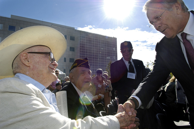 The Honorable Donald H. Rumsfeld, U.S. Secretary of Defense, meets with WWII veterans during the Alaska-Siberia Lend Lease memorial ceremony in Fairbanks, Alaska,  on Aug. 27, 2006. The memorial commemorates Russian and American aviators and support personnel that ferried more than 8,000 American-built airplanes through Great Falls Montana through Fairbanks for transfer to Russia during World War II.  (DoD photo by STAFF SGT. D. Myles Cullen) (Released)