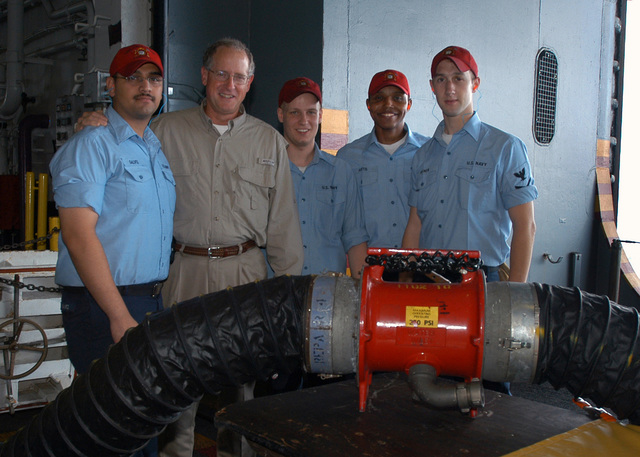 U.S. Navy crew members, Wasp Class Amphibious Assault Ship USS KEARSARGE (LHD 3), Damage Control Division, pose with U.S. Congressman Mike Conaway (R), 11th Congressional District of Texas in the hangar bay on Aug. 27, 2006. The KEARSARGE is particpating in PANAMAX 2006, a multi-national exercise tailored to the defense of the Panama Canal.(U.S. Navy photo by Mass Communication SPECIALIST SEAMAN Christopher Newsome) (Released)