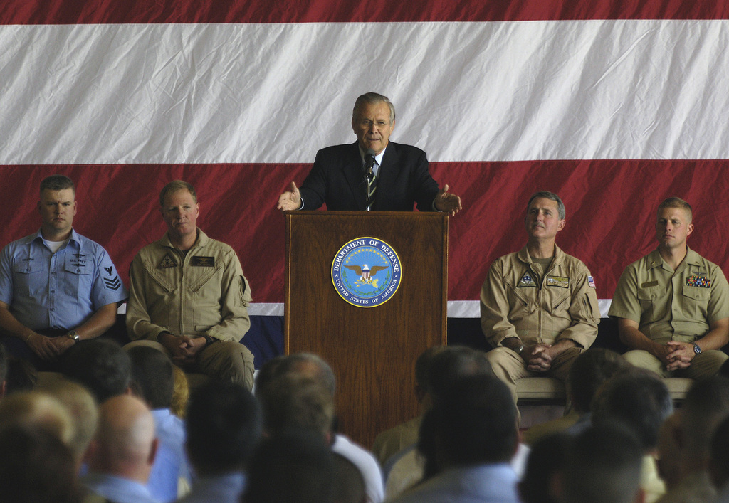 The Honorable Donald H. Rumsfeld, U.S. Secretary of Defense, addresses a crowd of U.S. Navy Sailors and civilian employees during a town hall meeting at the Fallon Naval Air Station, Nev., on Aug. 28, 2006.  (DoD photo by STAFF SGT. D. Myles Cullen) (Released)