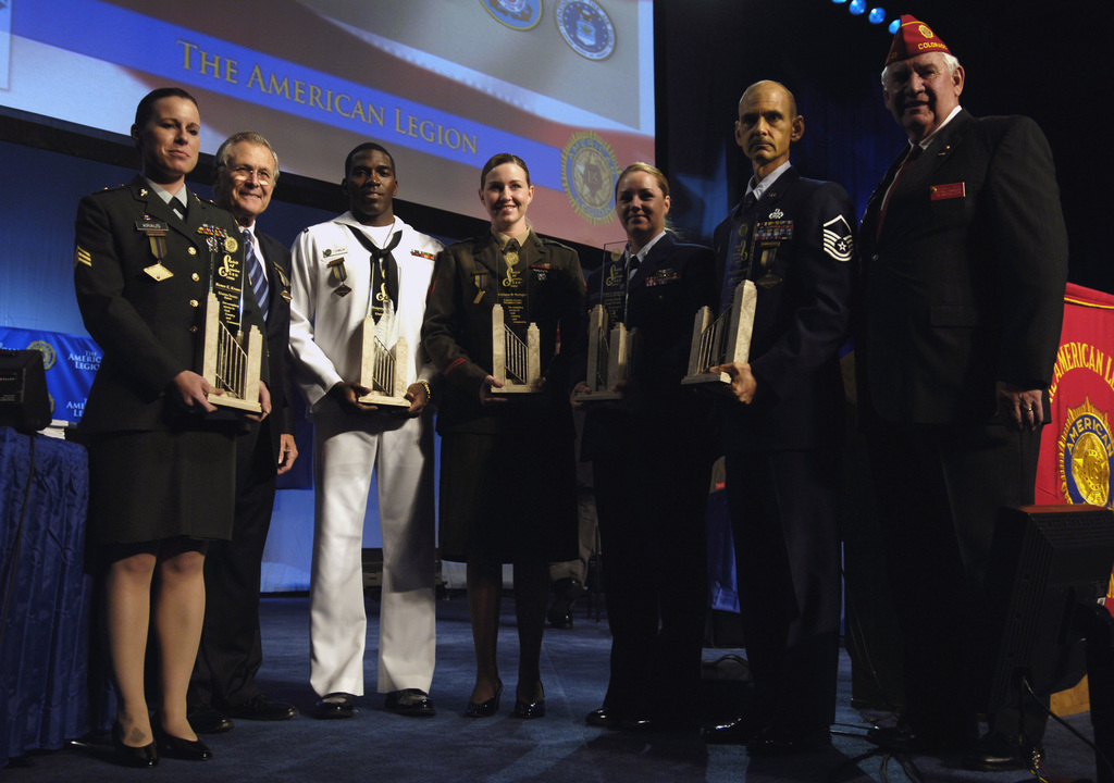 Left to right: U.S. Army SGT. Renee E. Kraus; The Honorable Donald H. Rumsfeld, U.S. Secretary of Defense; U.S. Navy PETTY Officer 2nd Class Dempsey L. Tomblin; U.S. Marine Corps SGT. Kristianna M. Huntington; U.S. Coast Guard PETTY Officer 2nd Class Katie S. Anthony; U.S. Air Force MASTER SGT. Edward J. Slavik, and American Legion National Commander Thomas L. Bock, pose for a photograph during the 88th Annual American Legion National Convention in Salt Lake City, Utah, on Aug. 29, 2006.  The Spirit of Service award was presented to each service member for their volunteer service in their local communities. (DoD photo by STAFF SGT. D. Myles Cullen) (Released)