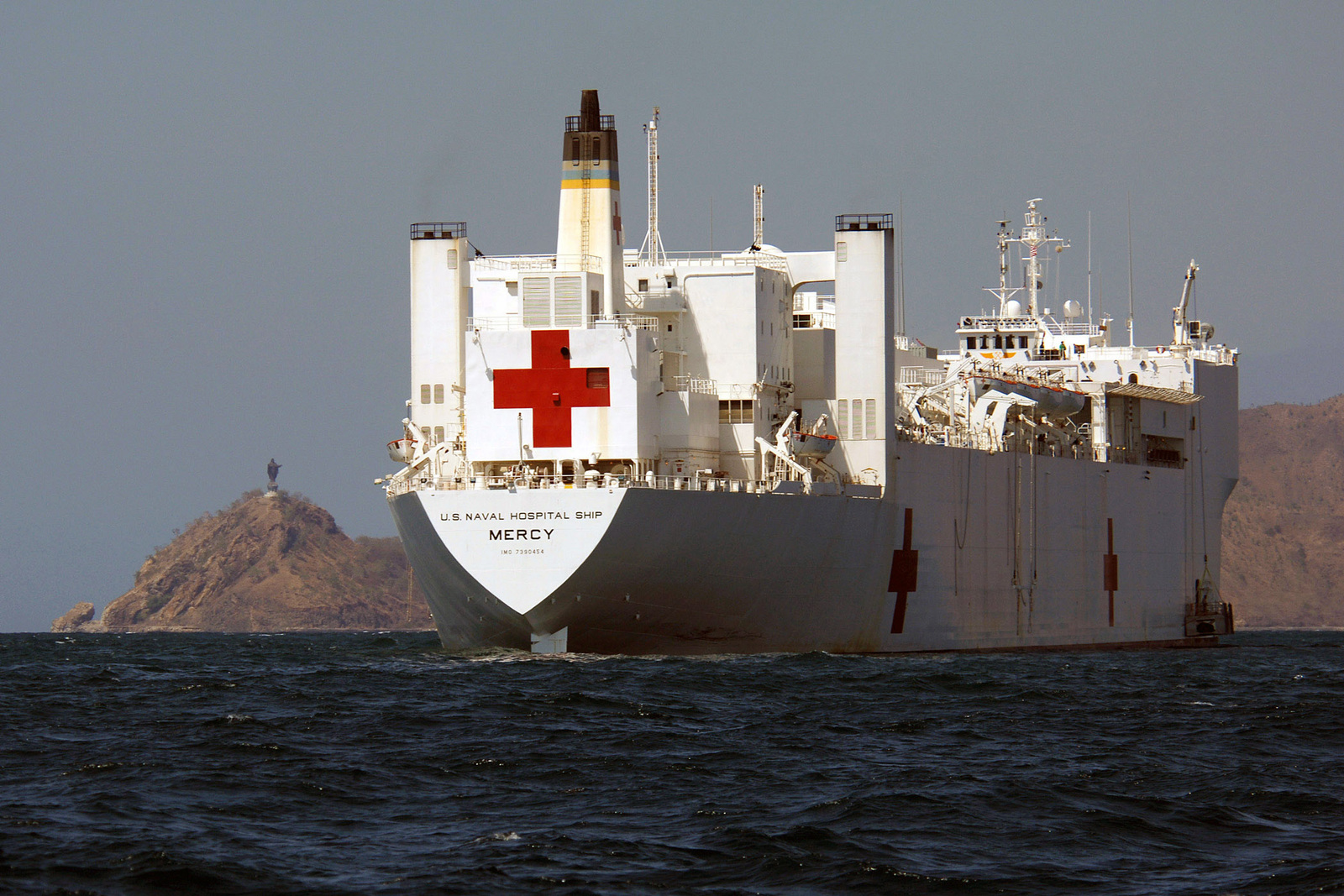 The U.S. Navy Military Sealift Command Mercy Class Hospital Ship USNS MERCY (T-AH 19) sits anchored in the Flores Sea, off the coast of Dili, East Timor, Indonesia, on Aug. 29, 2006. The MERCY is in the fourth month of a five-month humanitarian and civic assistance deployment to Southeast Asia. (U.S. Navy photo by CHIEF mass Communications SPECIALIST Edward G. Martens) (RELEASED)