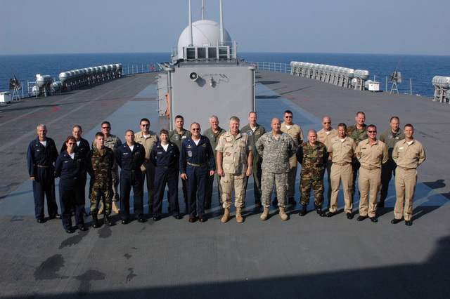 "U.S. Navy Commander, Joint Task Force Lebanon, Vice Adm. J.""Boomer""Stufflebeem (center front), CAPT. Joe Kuzmick, Commander, Blue Ridge Class Amphibious Command Ship USS MOUNT WHITNEY (LCC 20), (left center front), and the U.S. Army CHIEF of STAFF COL. Peri Anest, (right center front), pose with reservists aboard the MOUNT WHITNEY on Aug. 29, 2006. The MOUNT WHITNEY is deployed in support of operations in Joint Task Force Lebanon and the Eastern Mediterranean.(U.S. Navy photo by Mass Communication SPECIALIST Second Class Rosa Larson) (Released)"