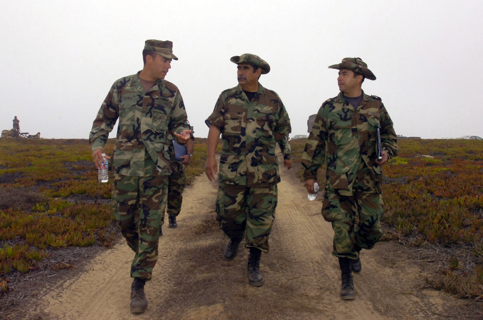 U.S. Navy LT. j.g. Steve Bower, left, from Naval Coastal Warfare Squadron (NCWRON) 5, escorts Mexican Navy officers to observe drills during Exercise Seahawk 2006 at Naval Amphibious Base, Coronado, Calif., on Aug. 29, 2006. Seahawk 2006 is a combined anti-terrorism and force protection training involving units under the U.S. Navy Expeditionary Combat Command (NECC) on the West Coast and Sailors from commands based in California, Washington and Oregon. (U.S. Navy photo by Mass Communication SPECIALIST 2nd Class Jennifer A. Villalovos) (Released)