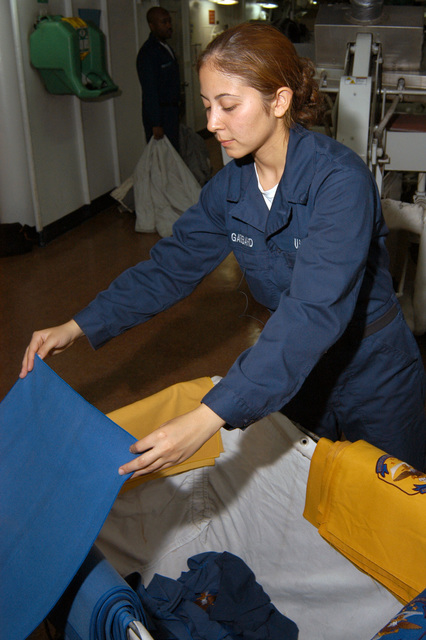US Navy Personnelman SEAMAN Christina Gabbard neatly stacks napkins onboard the Amphibious Command Ship USS BLUE RIDGE (LCC 19) during Exercise Ulchi Focus Lens. BLUE RIDGE is currently deployed in Southeast Asia supporting the 7th Fleet's interoperability and training commitments in maritime operations. (U.S. Navy photo by Mass Communication SPECIALIST 3rd Class David J. Hewitt) (Released)