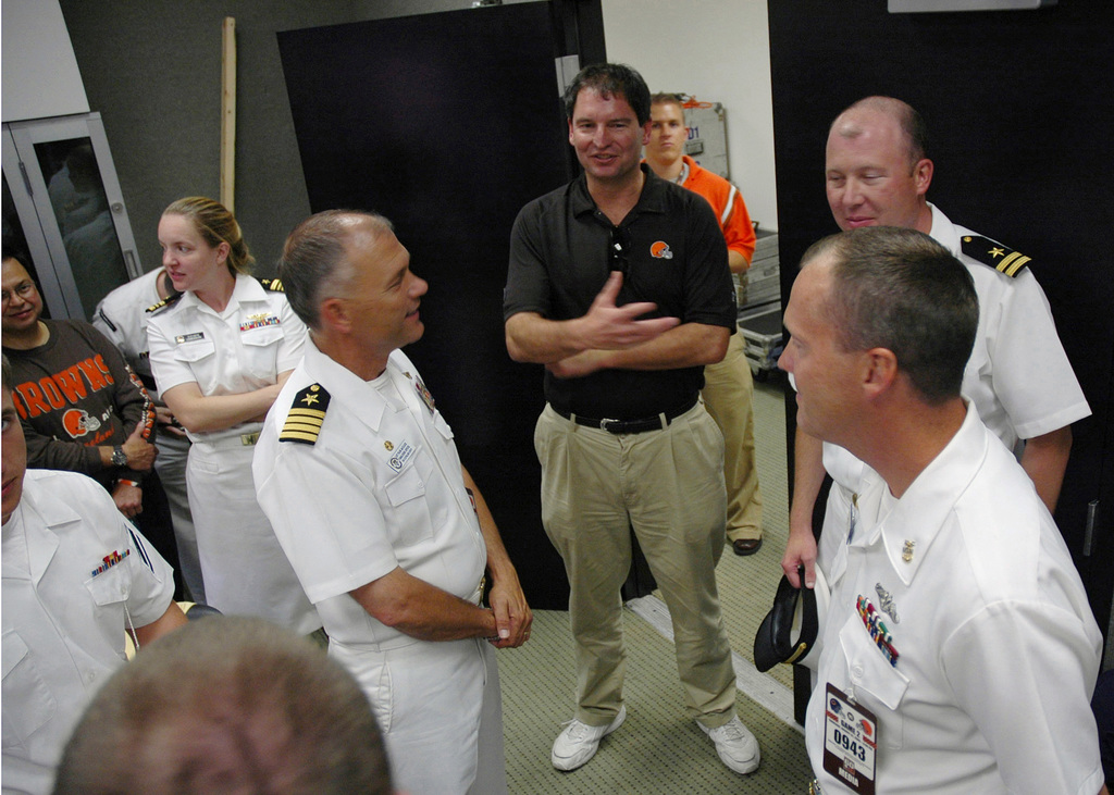 Bernie Kosar, center, former National Football League (NFL) Cleveland Browns quarterback, welcomes U.S. Navy Sailors from the Austin Class Amphibious Transport Dock USS CLEVELAND (LPD 7) before a Browns and Chicago Bears game during Navy Week at Cleveland, Ohio, at Aug. 31, 2006. The Cleveland Navy Week, which runs from Aug. 28-Sept. 4, 2006, features Navy participation in community events ranging from professional baseball and football games to the Cleveland National Air Show. (U.S. Navy photo by Mass Communication SPECIALIST 1ST Class Jason J. Perry) (Released)