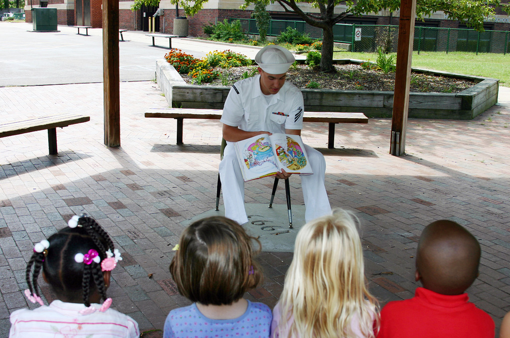 """U.S. Navy Culinary SPECIALIST SEAMAN Sean Unterdorfer,""""Blue Jacket Sailor of the Year""""from the Austin Class Amphibious Transport Dock USS CLEVELAND (LPD 7), reads a book for a kindergarten class at Roxboro Elementary School during Navy Week at Cleveland, Ohio, on Aug. 31, 2006. The Cleveland Navy Week, which runs from Aug. 28-Sept. 4, 2006, features Navy participation in community events ranging from professional baseball and football games to the Cleveland National Air Show. (U.S. Navy photo by Mass Communication SPECIALIST 2nd Class Michael Sheehan) (Released)"""