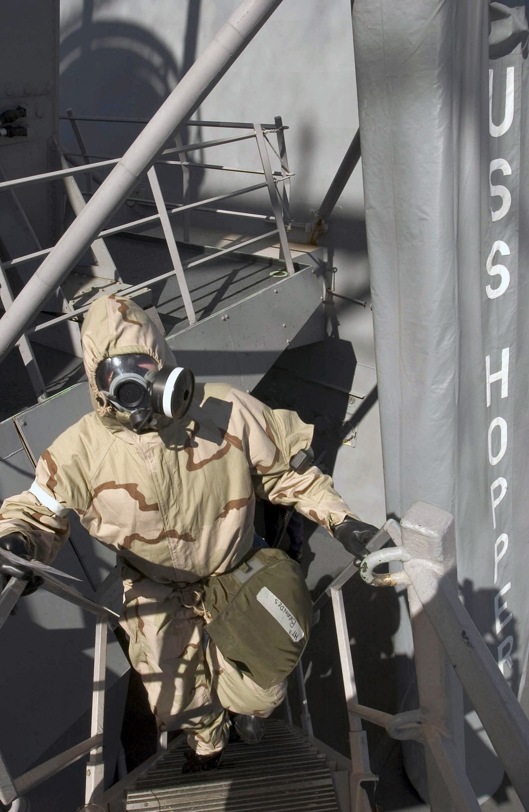 U.S. Navy Hull Technician Third Class Marc Brandes wears an Advanced Chemical Protective Garment, during a Chemical, Biological and Radiological drill aboard the Arleigh Burke Class Guided Missile Destroyer USS HOPPER (DDG 70) on Sep. 1, 2006. The HOPPER is on a scheduled deployment in support of Maritime Security Operations and the Global War on Terrorism.(U.S. Navy photo by Mass Communication SPECIALIST Second Class John L. Beeman) (Released)