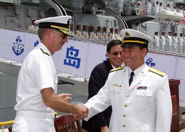 U.S. Navy Rear Adm. T. G. Alexander (left), Commander, Navy Region Hawaii, greets Chinese Peoples Liberation Army Navy Rear Adm. Wang Fushan, Deputy Commander, North Sea Fleet, following the arrival of two Chinese ships, the Luhu Class (Type 052) Guided Missile Destroyer QINGDAO (DDG 113) and the Fuquing Class Replenishment Ship HONGZEHU (AOR 881) at Naval Station Pearl Harbor, Hawaii, for a Goodwill Visit on Sept. 6, 2006. The visit provides an excellent opportunity to enhance cooperation between the two navies and underscores the United States commitment to supporting ongoing cooperative efforts in the Pacific Region. (U.S. Navy photo by CHIEF Mass Communication SPECIALIST David Rush)...