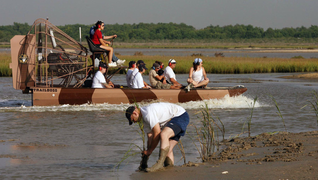 U.S. Navy Sailors from the Virginia Class New Attack Submarine Pre-Commissioning Unit (PCU) TEXAS (SSN 775) and civilian volunteers ride a fan boat before replanting marsh grass at Pierce Marsh, Hitchcock, Texas, on Sept.  6, 2006. The group participated in a project sponsored by the Galveston Bay Foundation, Natural Restoration Conservation Services and Energy Company NRG to help restore 200 acres of eroded vegetation in the area. TEXAS will be commissioned on Sept. 9, 2006 at Galveston, Texas. (U.S. Navy photo by Mass Communication SPECIALIST 2nd Class Roadell Hickman) (Released)