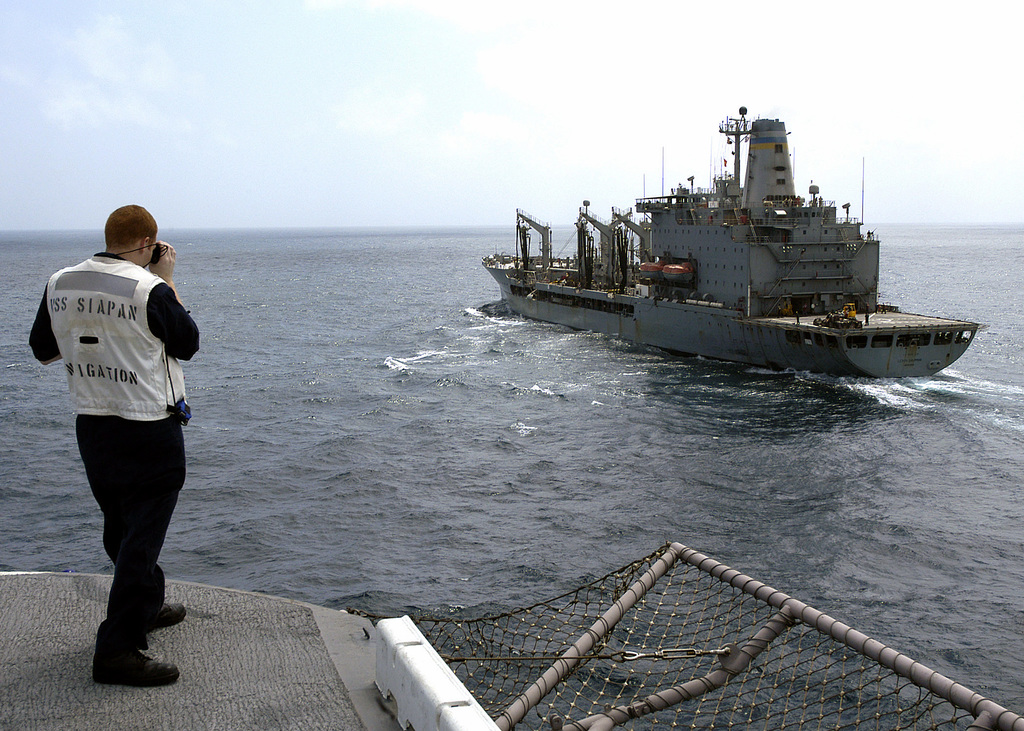 U.S. Navy Quartermaster Second Class Jason Lentz checks the distance between his ship, the Tarawa Class Amphibious Assault Ship USS SAIPAN (LHA 2), and the Military Sealift Command Henry J. Kaiser Class Oiler USNS LEROY GRUMMAN (T-AO 195) in preparation for an underway replenishment operation in the Gulf of Aden on Sept. 9, 2006. SAIPAN is currently underway conducting maritime security operations in the Persian Gulf. (U.S. Navy photo by Mass Communication SPECIALIST Third Class Gary L. Johnson III) (Released)
