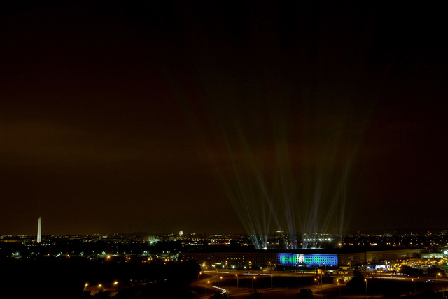 One hundred eighty four beams of light from the Pentagon courtyard, Washington, D.C., illuminate the night sky on Sept. 10, 2006 to commemorate each life lost at the Pentagon on the fifth anniversary of the Sept. 11, 2001 terrorist attacks in the country. (CHIEF Mass Communication SPECIALIST Johnny Bivera) (Released)