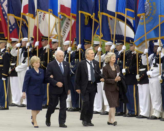 The Vice President and Mrs. Dick Cheney (left) and The Honorable Secretary of Defense and Mrs. Donald H. Rumsfeld (right), walk pass an honor cordon at the Pentagon, Arlington, Va. on Sep. 11, 2006, for ceremonies marking the 5th anniversary, of the terrorist attack on the Pentagon. (DoD photo by Robert D. Ward) (Released)