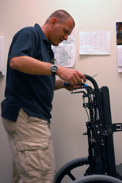 U.S. Navy Cryptologic Technician 1ST Class (SW) Michael Gordon, a cryptologic instructor for Combat Directions Systems Activity (CDSA) at Naval Air Station Oceana, Virginia Beach, Va., repairs and cleans a wheelchair at Saint Mary's Home for Disabled Children, Norfolk, Va., on Sept. 8, 2006. He is a member of the Volunteer Hampton Roads, a non-profit organization aimed at giving back to the Hampton Roads community. (U.S. Navy photo by Mass Communication SEAMAN Apprentice Matthew Bookwalter) (RELEASED)