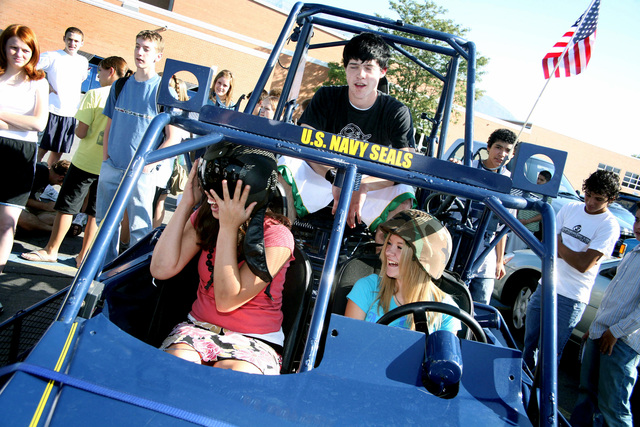 High school students get a close-up look at a U.S. Navy Desert Patrol Vehicle during Navy Week at Orem, Utah, on Sept. 12, 2006. Utah Navy Week is a 10-day series of more than 160 events designed to raise awareness of the Navy and enhance recruiting efforts in the region. (U.S. Navy photo by CHIEF Mass Communication SPECIALIST Gary Ward) (Released)