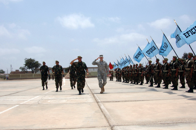 At Lambayeque, Peru, U.S. Army Brig. GEN. Ken Keen (left), U.S. Army South Commanding General, salutes along with Peruvian Brig. GEN. Javier Bouroncle, Commander of the 7th Infantry Brigade, during a pass-and-review ceremony for New Horizons 2006. New Horizons is a humanitarian assistance exercise with units from the U.S. Navy Naval Mobile Construction Battalion Five, Port Hueneme, Calif. and the U.S. ArmyΘs 416th Engineer Command, working alongside the Peruvian Army to construct three water wells, two clinics and a school in Western Peru. (U.S. Army PHOTO by Kaye Richey, CIV) (Released)