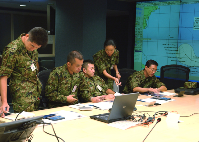 Washington, DC. -- September 18, 2006.  Japan's Ground Self-Defense Force Delegation discuss some of the concepts regarding crisis communications and the importance of managing expectations thru media vehicles. FEMA Photo by Bill Koplitz.