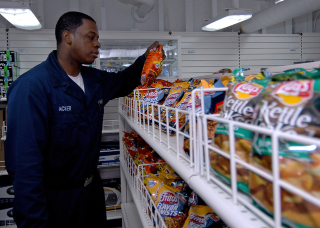 U.S. Navy Aviation Ordinanceman AIRMAN Tony D. Acker shops in the ship's store aboard the Wasp Class Amphibious Assault Ship USS IWO JIMA (LHD 7) on Sep. 21, 2006 in the Persian Gulf. The IWO JIMA is on a six-month deployment in support of Maritime Security Operations and the Global War on Terrorism.(U.S. Navy photo by Mass Communication SPECIALIST SEAMAN Christopher L. Clark) (Released)
