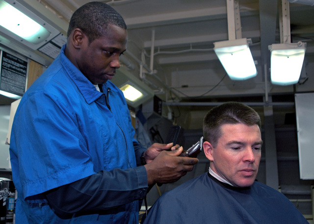 U.S. Navy Ship's Serviceman First Class Rony Kelley cuts the hair of a Sailor aboard the Wasp Class Amphibious Assault Ship USS IWO JIMA (LHD 7) on Sep. 21, 2006 in the Persian Gulf. The IWO JIMA is on a six-month deployment in support of Maritime Security Operations and the Global War on Terrorism.(U.S. Navy photo by Mass Communication SPECIALIST SEAMAN (AW) Joshua T. Rodriguez) (Released)