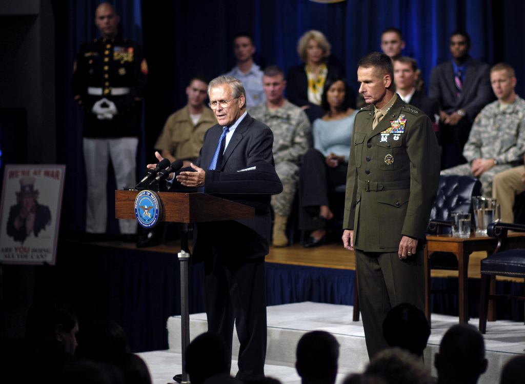 The Honorable Donald H. Rumsfeld (left), U.S. Secretary of Defense, and U.S. Marine Corps GEN. Peter Pace (right), Chairman of the Joint Chiefs of STAFF, address questions from U.S. Military Personnel and DoD civilians during a Town Hall meeting at the Pentagon, Washington, D.C., on Sept. 22, 2006. (DoD photo by STAFF SGT. D. Myles Cullen) (Released)