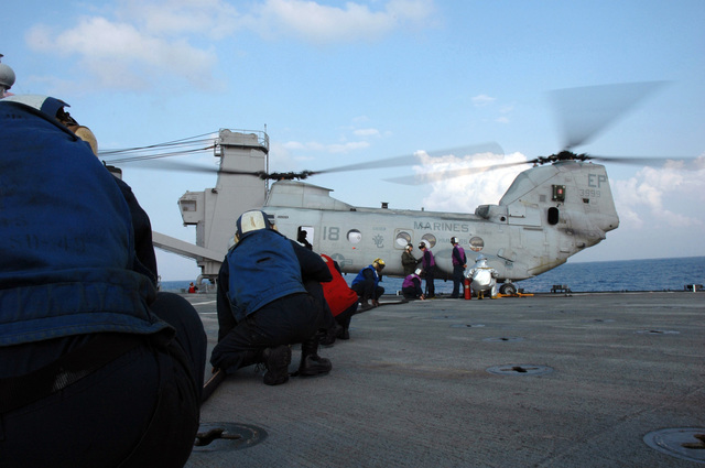 A U.S. Navy team refuels a U.S. Marine CH-46 Sea Knight helicopter aboard the Harpers Ferry Class Dock Landing Ship USS HARPERS FERRY (LSD 49), during deck landing qualifications on Sep. 24, 2006. The HARPERS FERRY is currently embarked on its fall patrol.U.S. Navy photo by Mass Communication SPECIALIST Second Class Brian P. Biller (Released)
