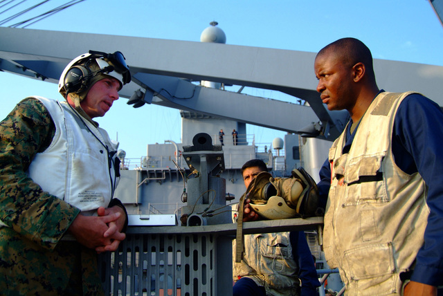 U.S. Marine GUNNERY SGT. Irvin W. Goodpasture, Combat Cargo Assistant, speaks to some of his younger Marines aboard the Harpers Ferry Class Dock Landing Ship USS HARPERS FERRY (LSD 49), during deck landing qualifications on Sep. 24, 2006. The HARPERS FERRY is currently embarked on its fall patrol.U.S. Navy photo by Mass Communication SPECIALIST SEAMAN Apprentice Charles Green (Released)