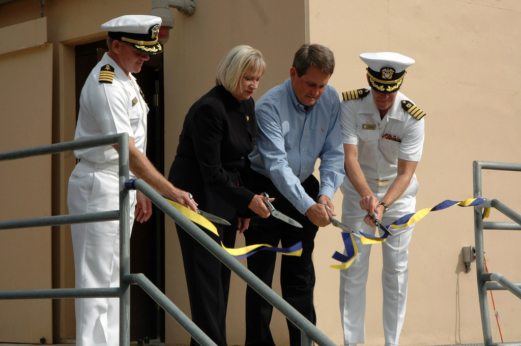 (From left-to-right), U.S. Navy CAPT. Chaz Heron, Commodore of Naval Special Warfare Group (NSWG) 2, Congresswoman Thelma Drake (R-Va.), Dave Simmons, Facility Manager and USN CAPT. Rick Roth, Commanding Officer Naval Facility Engineering Command Mid-Atlantic, cut the ribbon to officially open the Naval Special Warfare East Close Quarter Combat (CQC) Training Range, Fort Story, Va., on Sept. 25, 2006. This live-fire training range is used for basic to advanced CQC qualification levels and it is also used by Navy SEAL personnel for training. (U.S. Navy photo by Mass Communication SPECIALIST SEAMAN Recruit Chad R. Erdmann) (RELEASED)