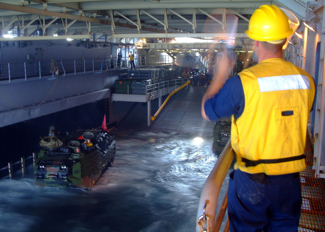 U.S. Navy Sailors perform traffic control, for a recovery training evolution, conducted in the well deck of the Harpers Ferry Class Dock Landing Ship USS HARPERS FERRY (LSD 49) on Sep. 29, 2006. The HARPERS FERRY is currently embarked on its fall patrol.U.S. Navy photo by Mass Communications SPECIALIST SEAMAN Apprentice Charles Green (Released)