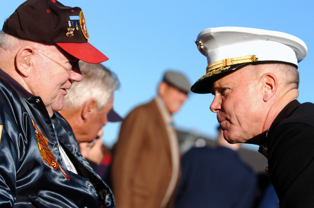 U.S. Marine Corps Marine LT. GEN. James F. Amos, Deputy Commandant for Combat Development and Integration, speaks with Medal of Honor recipient, Marine PFC. Jack Lucas during a turn-around cruise aboard USS CONSTITUTION, the world's oldest commissioned warship afloat, at Boston Harbor, Mass., on Sept. 30, 2006. Seventy Medal of Honor recipients got underway for a Medal of Honor flag presentation during the event. The Medal of Honor is our country's highest military honor, awarded for acts of valor above and beyond the call of duty. (U.S. Navy photo by Mass Communication SPECIALIST 1ST Class Chad J. McNeeley) (Released)