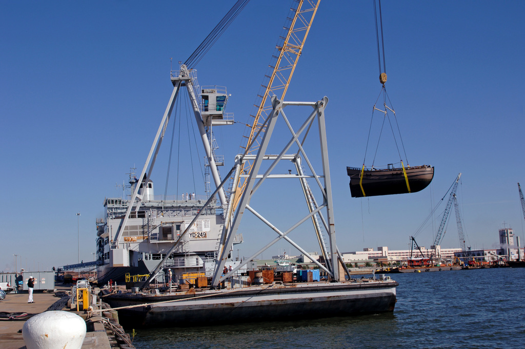 """The replica ship DISCOVERY is hoisted by a crane in before being loaded onto the British Royal Fleet Auxiliary Ship FORT ROSALIE (A385) at Naval Station Norfolk, Va., on Oct. 2, 2006 for transport to the United Kingdom. DISCOVERY will be the center-piece of a major tour promoting the 400th anniversary of the settlement in Jamestown, Va. A""""fly-boat""""of the British East India Company, DISCOVERY was the smallest of three ships that took part in the voyage from London to the new colony of Virginia, leading to the founding of Jamestown in 1607. (U.S. Navy photo by Mass Communication SPECIALIST SEAMAN Zach Hernandez) (Released)"""