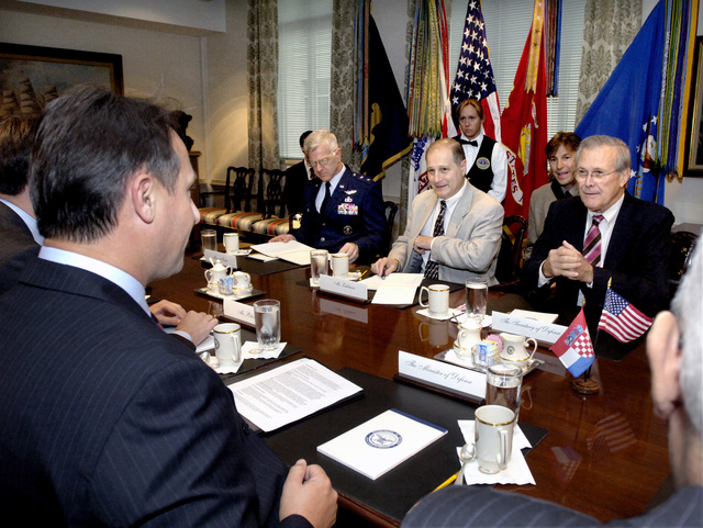 The Honorable Donald H. Rumsfeld (right), U.S. Secretary of Defense, U.S. Air Force MAJ. GEN. Scott Custer (far left), Vice Director of the General STAFF, and Eric Edelman (center), Under Secretary of Defense for Policy, meet with the Minister of Defense Berislav Roncevic (left) of Croatia Pentagon, Arlington, Va. on Oct. 5, 2006.(DoD photo by Robert D. Ward)  (Released)
