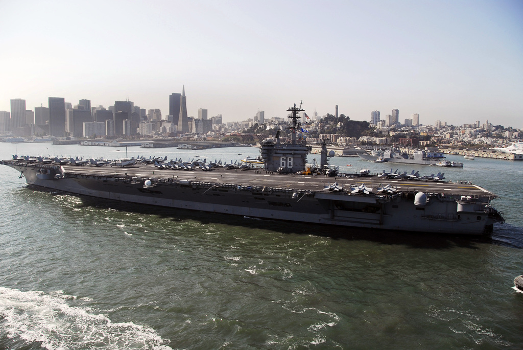 The U.S. Navy Nimitz Class Aircraft Carrier USS NIMITZ (CVN 68) steams into San Francisco Bay, San Francisco, Calif., on Oct. 7, 2006, during the Parade of Ships, the key event signaling the start of San Francisco Fleet Week 2006. Since 1981, San Francisco Fleet Week has been an annual opportunity for northern Californians to honor the men and women serving in the U.S. Navy, U.S. Marine Corps, and the U.S. Coast Guard. (U.S. Navy photo by Mass Communications SPECIALIST 2nd Class Shannon E. Renfroe) (Released)