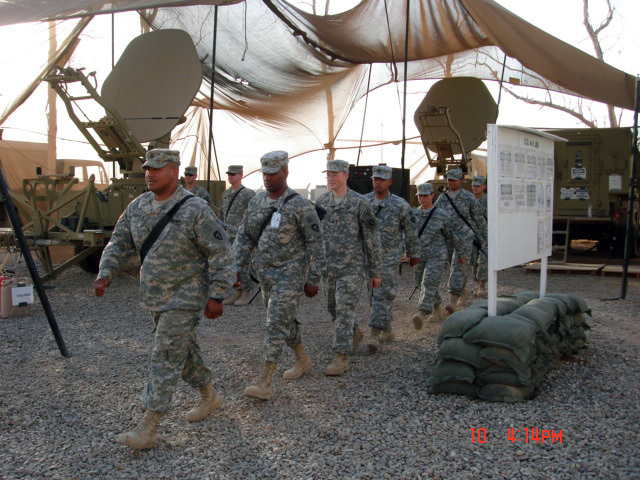 U.S. Army Soldiers assigned to Charlie Company, 449th Aviation Support Battalion, Texas Army National Guard, march to the promotion ceremony at the Joint Node Network (JNN) Site at Logistic Support Area, Anaconda, Balad Air Base, Iraq, on Oct. 10, 2006, during Operation Iraqi Freedom. (A3606) (U.S. Army PHOTO by SPC. Kaleena Calderas) (Released)
