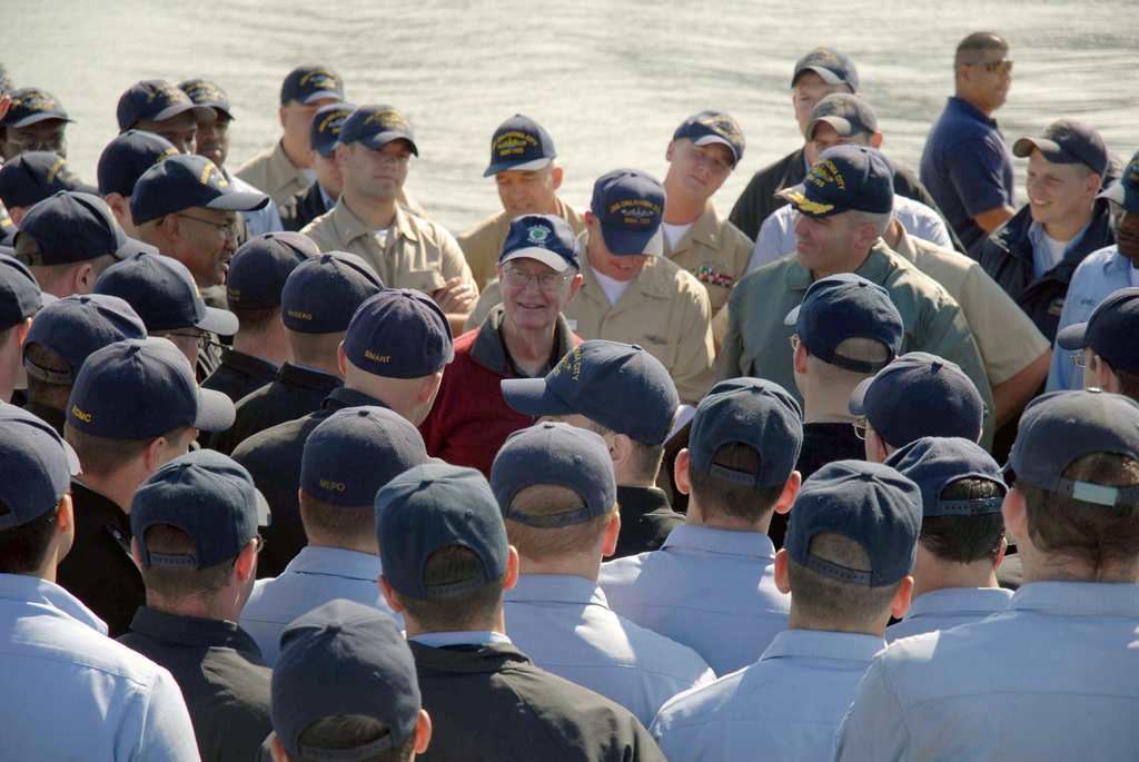 Mr. F. Neal Sever (center), a U.S. Navy World War Two Submarine Veteran, talks to U.S. Navy Sailor serving aboard the Los Angeles Class Attack Submarine, USS OKLAHOMA CITY (SSN 723) during his visit at Naval Station Norfolk Va., on Oct. 13, 2006.  Following his tour, Mr. Sever attended the time-honored dolphin pinning ceremony and gave a first hand account of the only ground-combat operation on Japanese territory in World War II. (U.S. Navy PHOTO by Mass Communication SPECIALIST 1ST Class Christina M. Shaw) (Released)
