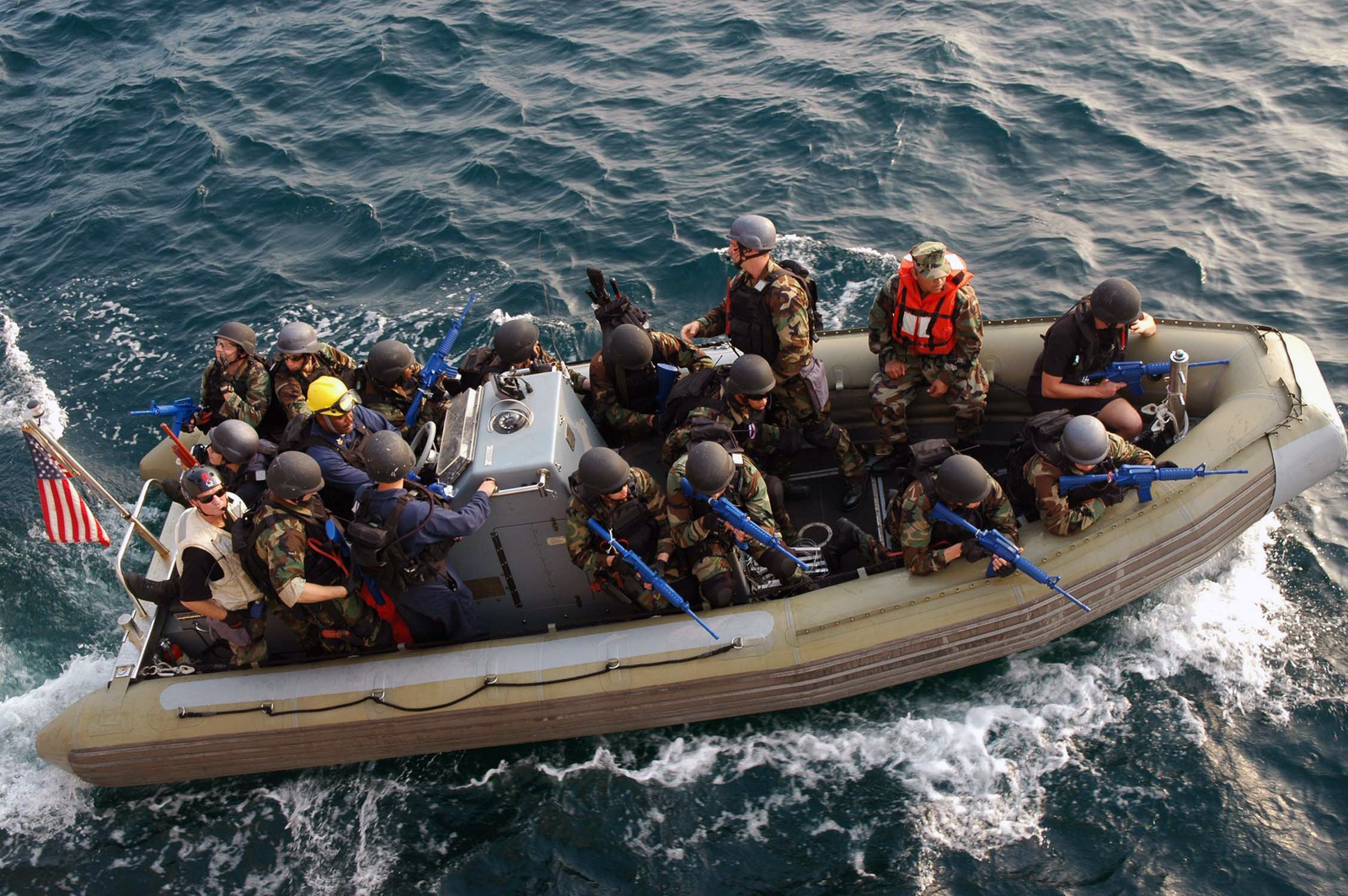 U.S. Navy Visit, Board, Search and Seizure team, armed with Blueguns, firearm simulators, set out on board a rigid hull inflatable boat to board a simulated suspicious vessel on Oct. 13, 2006. The Sailors are assigned to the U.S. Navy (USN) Oliver Hazard Perry Class Guided Missile Frigate USS GARY (FFG 51). (U.S. Navy photo by Information Systems Technician Second Class Scott Parish) (Released)
