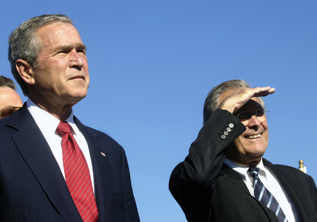 "US President George W Bush (left) and The Honorable Donald H. Rumsfeld (right), U.S. Secretary of Defense, watch the U.S. Air Force Air Demonstration Squadron""Thunderbirds""(not shown) perform during the conclusion of the dedication ceremony for the U.S. Air Force Memorial near the Pentagon, Washington, D.C., on Oct. 14, 2006. (DoD photo by STAFF SGT. D. Myles Cullen) (Released)"