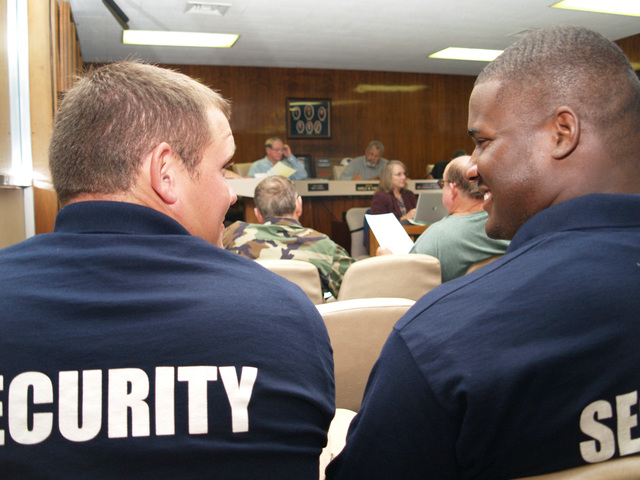 [Hurricane Katrina] Baker, La., October 24, 2006 - Security Team members Nicholas Nowak (l) and Andrew Williams (r) receive honorary positions with the city of Baker in recognition of their rescue of an elderly woman from a burning trailer at FEMA's Renaissance Village park. The men braved flames to carry the woman out of her home after she had fallen asleep and did not hear the smoke detector alarm. Keith Riggs/FEMA.