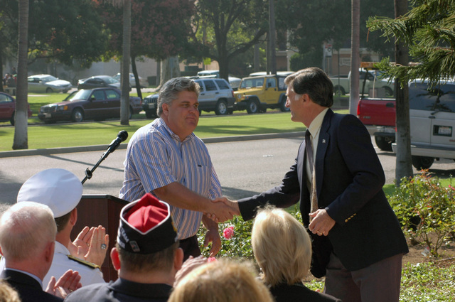 Mr. Taylor Stockdale (left), son of retired U.S. Navy Vice Adm. James Bond Stockdale, greets Mayor Tom Smisek, from the city of Coronado, Calif., during a ceremony at the Coronado Public Library on Oct. 24, 2006. The ceremony is being held to honor and commemorate the services and sacrifices of Admiral Stockdale who passed away one year ago. (U.S. Navy PHOTO by Mass Communication SPECIALIST SEAMAN Recruit Omar A. Dominquez) (Released)