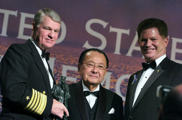 U.S. Navy Adm. Gary Roughhead (right), Commander, U.S. Pacific Fleet and President and CHIEF Executive Officer (CEO) of the United States Navy Memorial and retired Rear Adm. Richard A. Buchanan, present Sen. Daniel Inouye (D-HI) with the 2006 Navy Heritage Award at Lone Sailor Awards Dinner at the Grand Hyatt Hotel. (U.S. Navy PHOTO by Mass Communication SPECIALIST 1ST Class Chad J. McNeeley) (Released)
