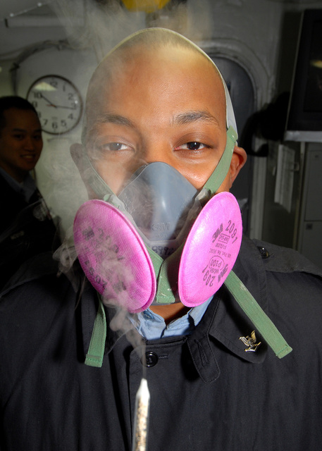 U.S. Navy Aviation Ordnanceman 3rd Class Lorenzo Chapman, Safety Department, NIMITZ Class Aircraft Carrier USS ABRAHAM LINCOLN (CVN 72), endures irritant smoke to demonstrate the proper procedure for conducting a respirator fit test aboard the LINCOLN on Oct. 26, 2006, while the LINCOLN is in dry dock at the Puget Sound Naval Shipyard, Puget Sound, Wash., undergoing rehabilitation and maintenance during a planned dry dock incremental availability period (DPIA). (U.S. Navy photo by Mass Communications SPECIALIST SEAMAN James R. Evans) (RELEASED)