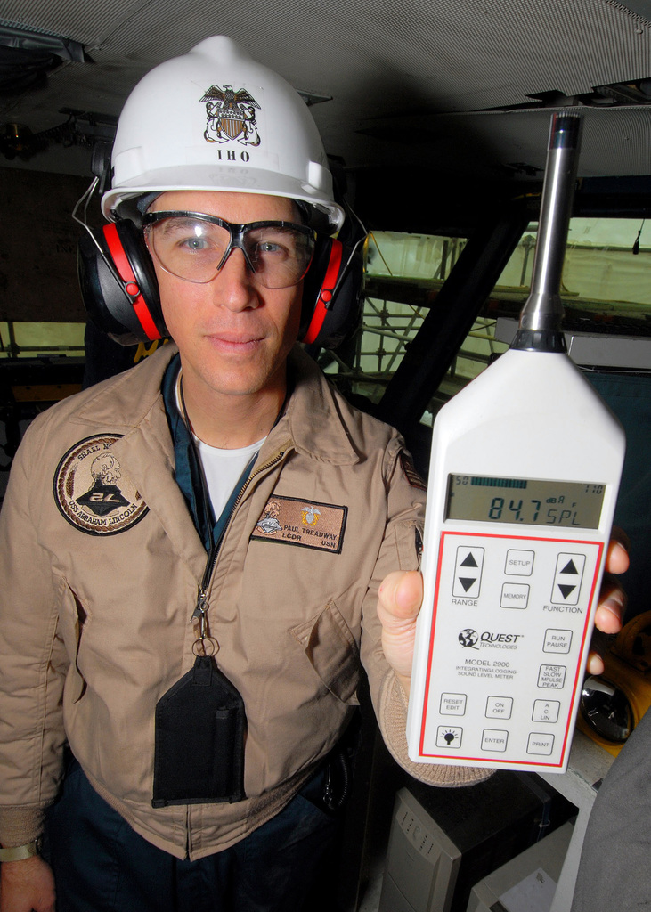 U.S. Navy LT. CMDR. Paul Treadway, Industrial Hygiene Officer and Assistant Safety Officer aboard the Nimitz Class Aircraft Carrier USS ABRAHAM LINCOLN (CVN 72), uses a sound-level meter on Oct. 26, 2006, to demonstrate the high decibel levels on the FLAG Bridge as spaces are being rehabilitated, while the LINCOLN is in dry dock at the Puget Sound Naval Shipyard, Puget Sound, Wash., undergoing rehabilitation and maintenance during a planned dry dock incremental availability period (DPIA). (U.S. Navy photo by Mass Communications SPECIALIST SEAMAN James R. Evans) (RELEASED)