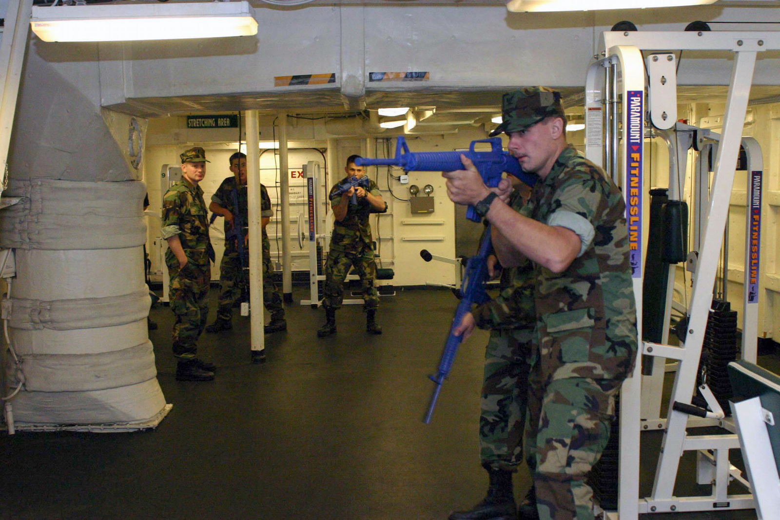U.S. Navy (USN) members, armed with firearm simulators, of the visit, board, search, and seizure team, assigned to the USN Whidbey Island Class Dock Landing Ship USS TORTUGA (LSD 46), search for simulated stowaways, aboard the shipΘs assigned berthing barge during a drill on Oct. 26, 2006. (U.S. Navy photo by Mass Communication SPECIALIST Second Class David J. Ham) (Released)